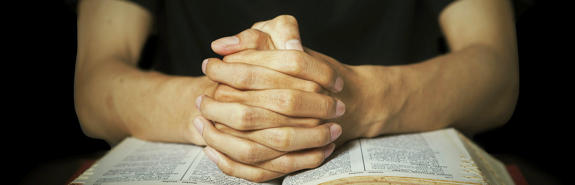 praying hand and Bible