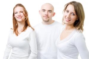 women and man in white shirt
