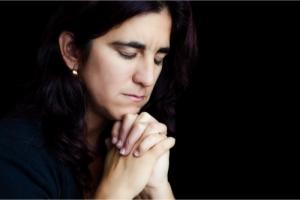 woman praying intently